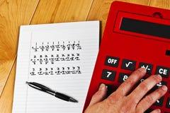 Pena das equações da mão da calculadora Imagem de Stock