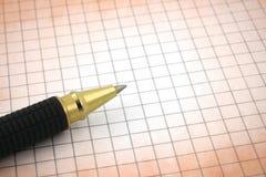 Pena de Ballpoint no papel de gráfico Imagem de Stock Royalty Free