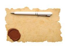Pena de Ballpoint no papel velho com cera do selo Fotografia de Stock Royalty Free
