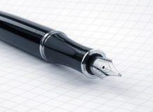 Pena de fonte no papel de gráfico fotografia de stock