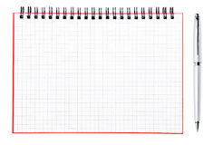 Pena de prata e página em branco de um caderno Fotos de Stock