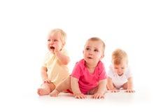 Pena del ` s de los niños de los tres bebés Imagen de archivo