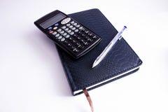 Pena e calculadora do caderno Imagem de Stock Royalty Free