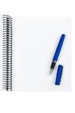Pena e folha em branco do caderno fotografia de stock