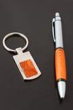 Pena e keychain Imagem de Stock Royalty Free