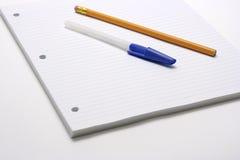 Pena e lápis no papel alinhado Fotos de Stock Royalty Free