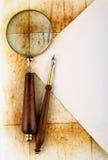 Pena e magnifier Imagem de Stock Royalty Free