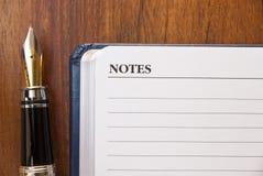 Pena e notas de fonte foto de stock royalty free