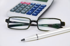 Pena e vidros da calculadora Imagem de Stock Royalty Free