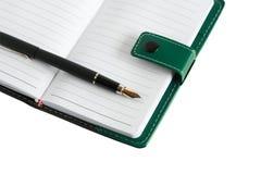 Pena no caderno Foto de Stock