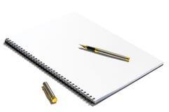 Pena no caderno branco Imagens de Stock