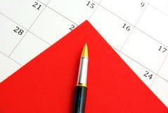 Pena no calendário Fotos de Stock