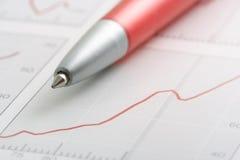 Pena no gráfico Fotografia de Stock