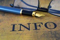 Pena no texto de informação Fotografia de Stock