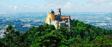 Pena Palace. Colorful Pena Palace, famous palace and one of the seven wonders in Portugal (panoramic picture Royalty Free Stock Images