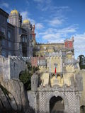Pena Palace. Pena National Palace in Sintra, Portugal on a clear day with some clouds and a view of many towers and the castle façade royalty free stock images