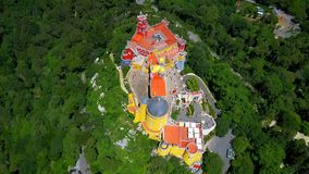 Aerial footage. Palace of Pena, Sintra, Lisbon, Portugal. The Pena Palace Portuguese: Palácio da Pena is a Romanticist castle in São Pedro de Penaferrim, in stock footage