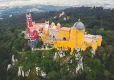 The Pena Palace, a Romanticist castle in the municipality of Sintra, Portugal, Lisbon district, Grande Lisboa, aerial view, shot stock photos