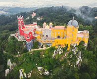 The Pena Palace, a Romanticist castle in the municipality of Sintra, Portugal, Lisbon district, Grande Lisboa, aerial view, shot stock photo