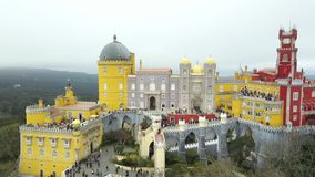The Pena Palace, a Romanticist castle in the municipality of Sintra, Portugal, Lisbon district, Grande Lisboa, aerial view. Shot from drone. Camera is