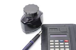 Pena, tinta e calculadora Imagem de Stock Royalty Free