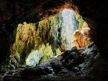 Light enters a chamber of Callao Cave through the rooftop royalty free stock photography
