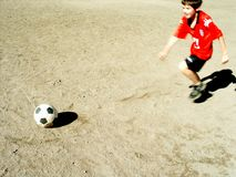 Penalty. Lying ball and running boy Stock Photography