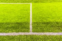 Penaty area, white lines of the artificial practice football field. Penalty area, white lines of the artificial practice football field in urban, daytime Royalty Free Stock Photos