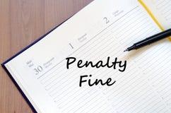 Penalty fine write on notebook. Penalty fine text concept write on notebook with pen Royalty Free Stock Photo