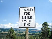 Penalty for littering sign. In the forest Royalty Free Stock Photography