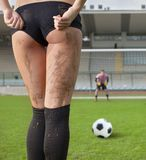 Penalty. Picture of a sexy woman before a penalty kick. Goalkeeper in background Royalty Free Stock Image