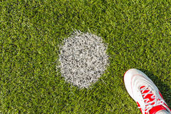 Penalty point on soccer pitch. Penalty point on artificial grass soccer pitch or indoor futsal pitch with futsal shoe Royalty Free Stock Image