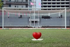 Penalty spot of soccer field with heart Royalty Free Stock Photo