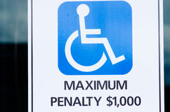 Penalty Wheelchair sign disabled car park Royalty Free Stock Image