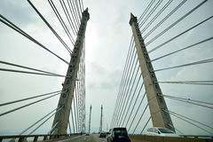 Penang Bridge. The Penang Bridge, route E36, is a 13.5-kilometre (8.4-mile) dual carriageway toll bridge and controlled-access highway in the state of Penang stock photography