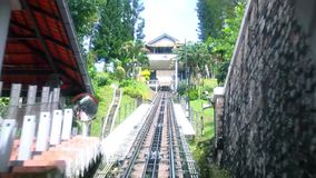 POV time lapse of Penang Hill Ride on cable car, Georgetown, Malaysia. View from inside. Penang Hill Ride on cable car, Georgetown, Malaysia stock footage