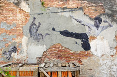PENANG, MALAYSIA - APRIL 18, 2016: General view of a mural `The Real Bruce Lee Would Never Do This` painted by 101 Lost Kittens in. Penang on JULY 6,2013. The Stock Photo