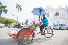 Penang, Malaysia - August 10-2015 :: three-wheeler in front of P Royalty Free Stock Image