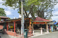Penang, Malaysia - Dec 14, 2015: A small temple at the entrance of the Chew Jetty, Penang, Malaysia. Royalty Free Stock Photography