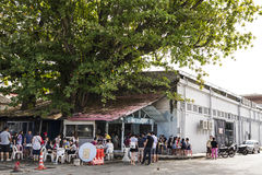 PENANG, MALAYSIA - Dec 13, 2015: Unidentified visitors queuing at road side to be served at famous old food shop at Penang. Royalty Free Stock Photography