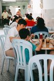 Family eating out at a restaurant in Penang. Penang, Malaysia - December, 2015 : Family eating out at a restaurant in Penang stock image