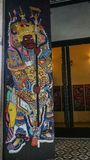 God paints on the temple door stock photo