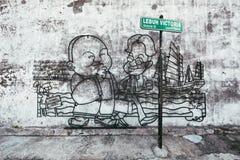 PENANG MALAYSIA - NOVEMBER 1 2014: Penang trådkonst och väggmålning på den Victoria gatan Arbetet för trådramkonster är runt om G royaltyfri fotografi