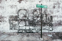 PENANG, MALAYSIA - NOVEMBER 1 2014: Penang wire art and mural at Victoria street. The wire frame arts work is around the. Georgetown heritage zone royalty free stock photography