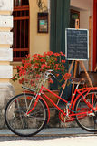 PENANG, MALAYSIA - NOVEMBER 1, 2014 : Red old bicycle ,street  Jalan Sehala,George Town Royalty Free Stock Image