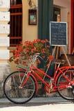 PENANG, MALAYSIA - NOVEMBER 1, 2014 : Red old bicycle ,street  Jalan Sehala,George Town. PENANG, MALAYSIA - NOVEMBER 1, 2014 : Red old bicycle ,George Town Royalty Free Stock Image