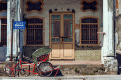 PENANG, MALAYSIA - NOVEMBER 1, 2014 : Red Trishaw,street Jalan Sehala ,George Town. PENANG, MALAYSIA - NOVEMBER 1, 2014 : Red  Trishaw,street Jalan Sehala Stock Photos