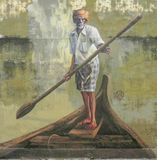 Public street art in Georgetown `Old man with a paddle on a boat` royalty free stock images