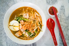 Penang popular prawn mee noodles with eggs, and small shrimp. No frills popular Penang prawn mee noodles with eggs, and small shrimp stock photos