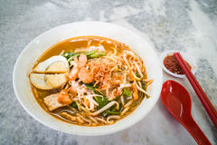 Penang popular prawn mee noodles with eggs, and small shrimp. No frills popular Penang prawn mee noodles with eggs, and small shrimp royalty free stock photography